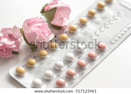 concept of female contraception on white background