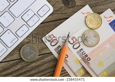 concept of finance, with money and stationery in the background - stock photo