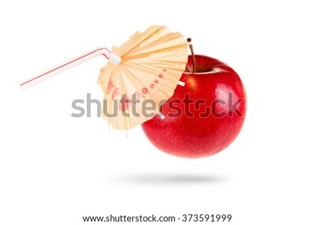 Concept of fresh apple juice featuring an apple with a straw and umbrella isolated on white background.  - stock photo