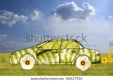 Concept of green car made from leaves and flowers - stock photo
