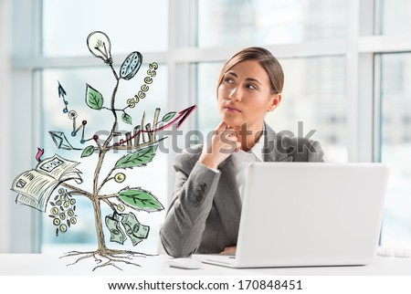 Concept of Growing company with sketch of a plant with business symbols and businesswoman working on laptop - stock photo