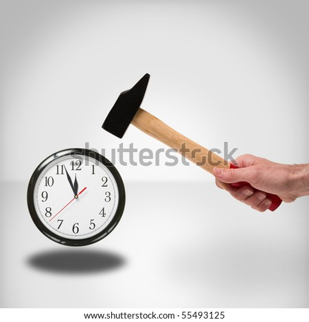 concept of hammer striking a clock to manage time - stock photo