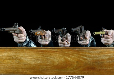 concept of hand pistol on black background - stock photo