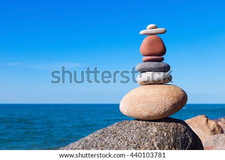 Concept of harmony and balance. Balance and poise stones against the sea. Rock zen in the form of scales - stock photo