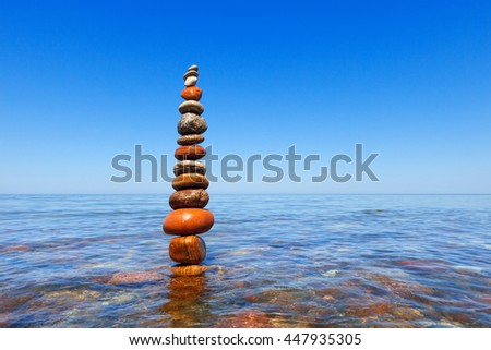 Concept of harmony and balance. Rock Zen in water. Balance and poise stones against the sea - stock photo