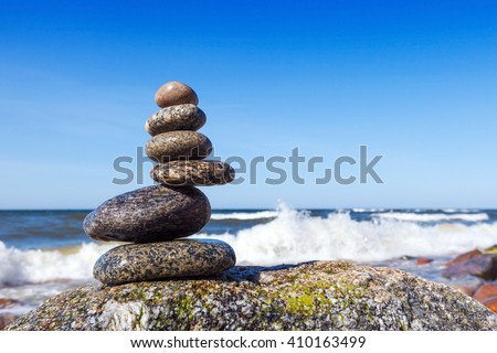 Concept of harmony and balance. Rock Zen on a background of a summer storm - stock photo