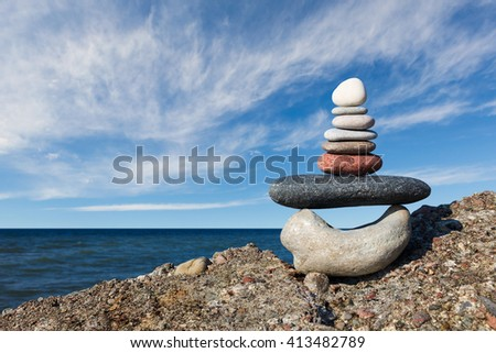 Concept of harmony and balance. Rock Zen on the background of summer sea - stock photo
