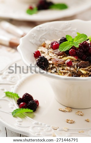 Concept of healthy breakfast with muesli, selective focus