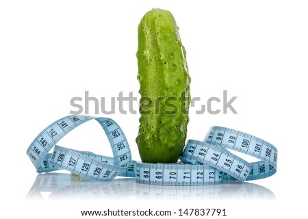 Concept of healthy eating - fresh cucumber and measuring tape