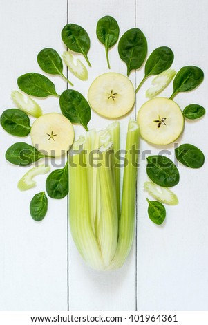 Concept of healthy eating. Ingredients for making vitamin green smoothie of spinach, celery and apples. Vertical, top view  - stock photo