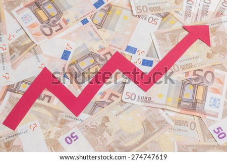 Concept of increase of euro value with red arrow growing over notes background - stock photo
