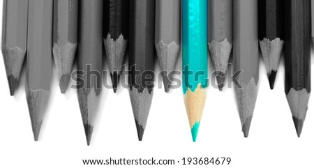 Concept of individuality.One bright color pencil among grey pencils - stock photo