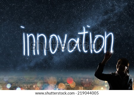 Concept of innovation, silhouette asian business woman light drawing. - stock photo