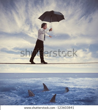 Concept of insurance with businessman on the rope - stock photo
