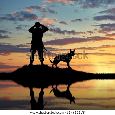 Concept of intelligence. Silhouette of a dog and a soldier looking through binoculars at sunset - stock photo