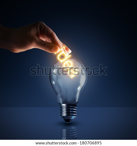 concept of investing in their ideas - piggy bank - bulb  - stock photo
