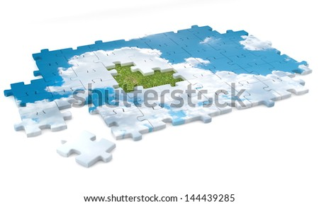 Concept of jigsaw puzzle with clouds and grass/ground. - stock photo