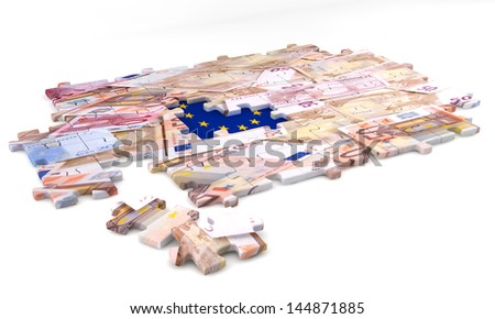 Concept of jigsaw puzzle with European flag and money. - stock photo