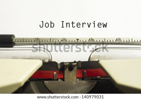 concept of job interview, with message on typewriter. - stock photo