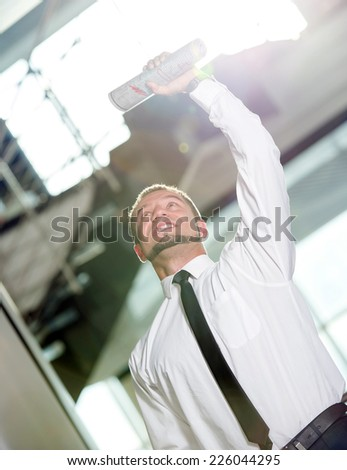 Concept of job search.  Happy young man, found a job. - stock photo