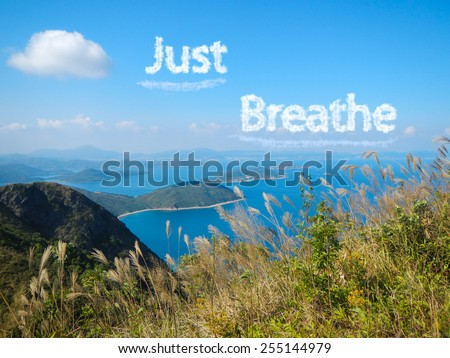 concept of just breathe, cloud message on sky with country park background - stock photo