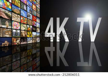 Concept of 4K TV on black background with reflection - stock photo