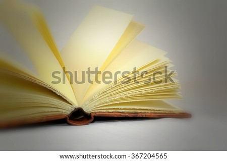 Concept of knowledge. Open book. - stock photo