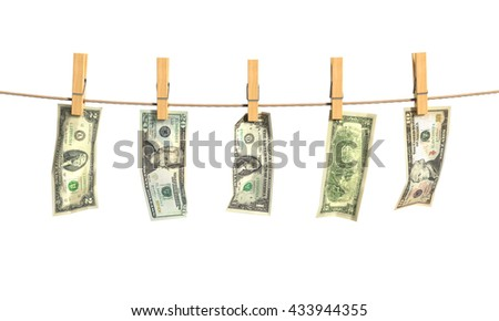 Concept of laundering of money. Different denominations of money bills hang on the fixed clothespins to the rope. 3d illustration - stock photo