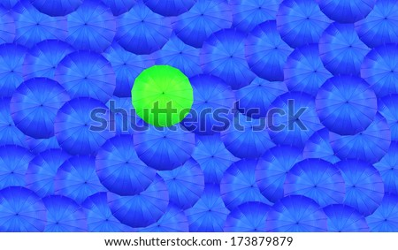 Concept of leader with with many blue and a  green umbrella - stock photo