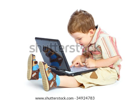 Concept of little businessman. Little child and laptop. Isolated on white background - stock photo