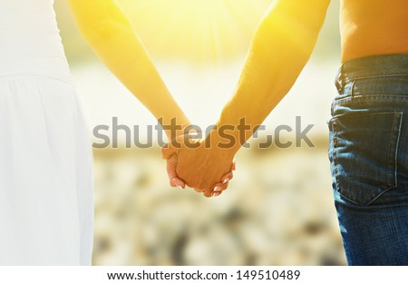 concept of love and family. the hands of lovers, men and women in beach - stock photo