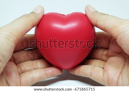 Concept of love, holding red heart in hand