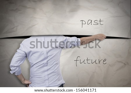 concept of man cutting with the past but is afraid of the future - stock photo