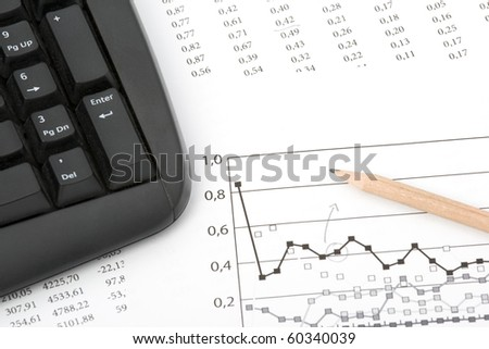 Concept of market share analysis - pencil; graph; sheet with numbers and keyboard - stock photo
