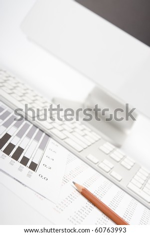 Concept of market share analysis - pencil; graph; sheet with numbers, keyboard and computer - stock photo