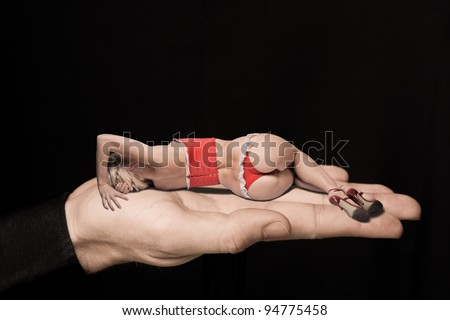 Concept of men's love to woman. In the man's hands lying beautiful naked woman in mask. Shallow depth of field. Digital composition - stock photo