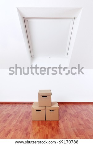 Concept of moving and assembling - empty room with moving boxes - stock photo