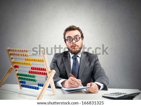 Concept of nerd with financial businessman with calculator - stock photo