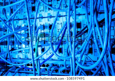 Concept of  network infrastructure with cables connected to data center - stock photo