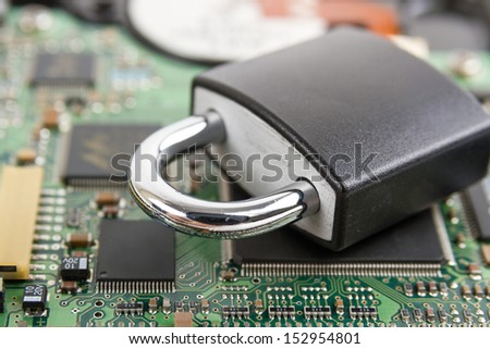 Concept of network security. Locker on computer board.  - stock photo