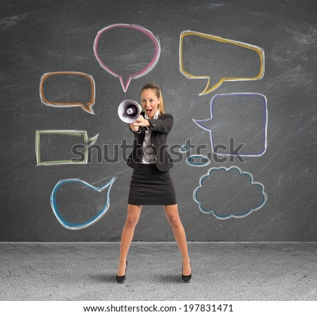 Concept of new message with businesswoman with megaphone - stock photo