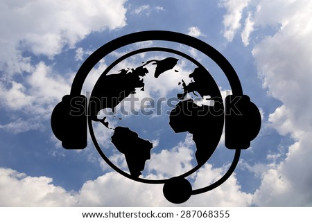 concept of news. Planet earth with headphones on background cloudy sky. design element - stock photo