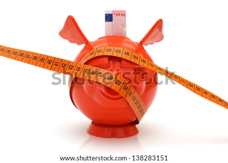 concept of no money with piggy bank and measuring tape - stock photo
