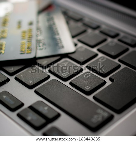 Concept of online shopping with keyboard and credit card - stock photo
