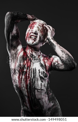Concept of pain, a man with blood on his wounds and skin - stock photo
