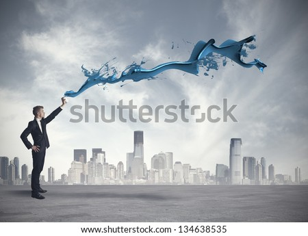 Concept of paint a gray city with spray - stock photo