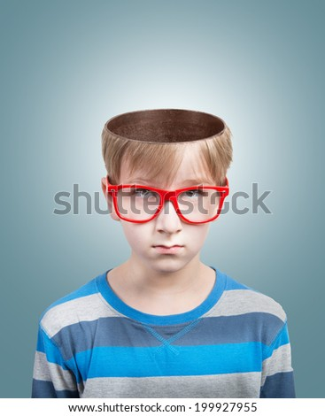 Concept of preteen boy with opened head looking at camera - stock photo