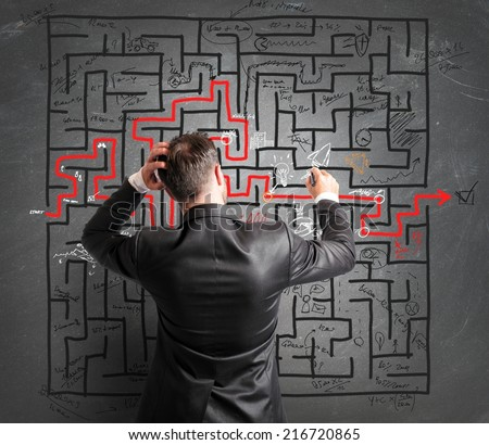 Concept of problem and confusion of a businessman - stock photo