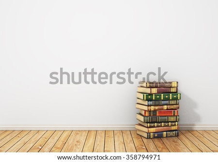 Concept of reading. Stack of colorful book on the wooden floor with empty wall. - stock photo