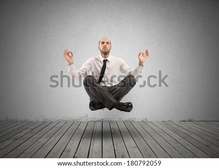 Concept of relax with businessman doing yoga - stock photo